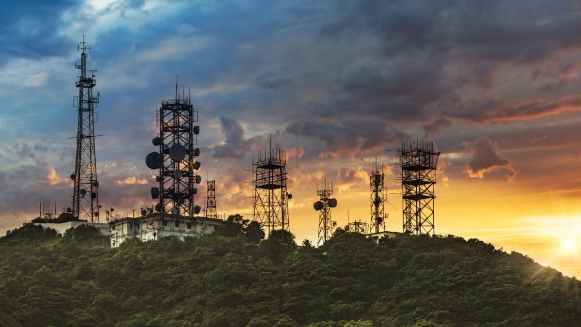 Silhouette antenna tower and repeater of Communication and telecommunication with the mountain on the background of sunset. Photo: iStock