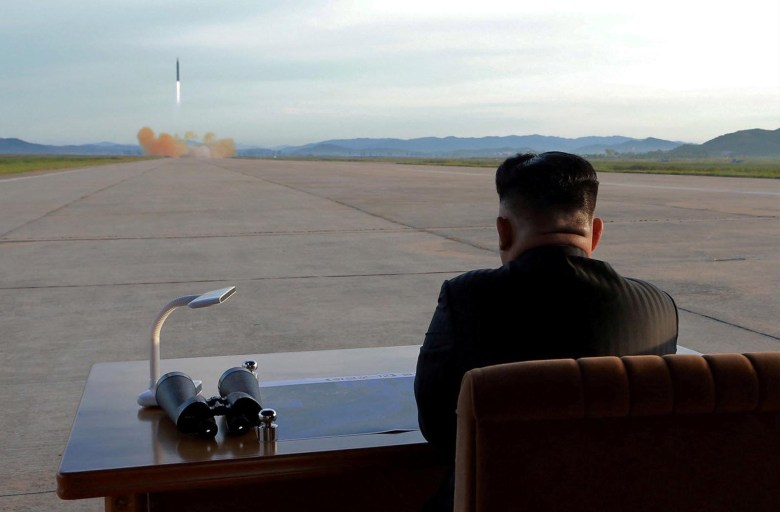 North Korean leader Kim Jong Un watches the launch of a Hwasong-12 missile in this undated photo released by North Korea's Korean Central News Agency on September 16, 2017. Photo: KCNA via Reuters Photo was provided by a third party. Reuters is unable to verify authenticity
