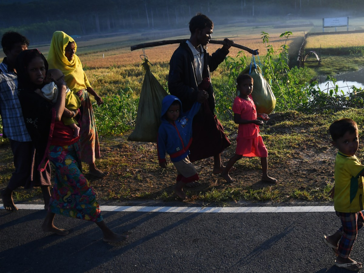 Thousands of Rohingya Muslims have fled to neighboring Bangladesh to escape military persecution in Rakhine state in Myanmar. The author says the government of Myanmar needs to work with minority groups such as the Rohingya to establish an all-inclusive national identify.   Photo: AFP/Dibyangshu Sarkar