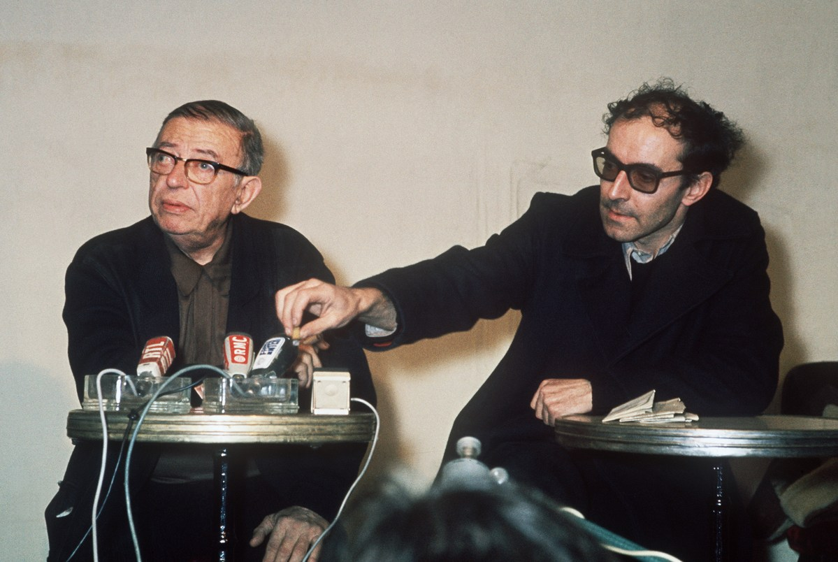 "Sartre (left) and Jean-Luc Godard, one of the leaders of French ""nouvelle vague"" cinema movement, address journalists in February 1971, in Paris. Photo: AFP"