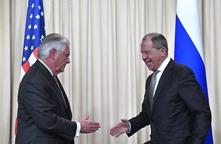 Russian Foreign Minister Sergey Lavrov shakes hands with US Secretary of State Rex Tillerson last April in Moscow. Photo: AFP / Alexander Nemenov