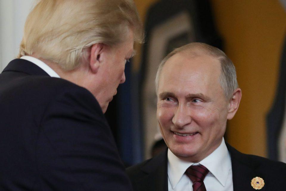 US President Donald Trump chats with Russia's President Vladimir Putin as they attend the APEC Economic Leaders' Meeting in Danang, Vietnam, on November 11, 2017. Photo: AFP / Sputnik/ Mikhail Klimentyev