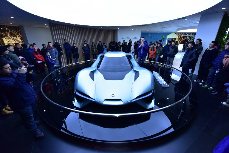 A NextEV Nio EP9 electric supercar is on display during an automobile exhibition in Beijing. Nio's ES8, launched over the weekend hopes its low price will attract customers away from Tesla. Photo: AFP