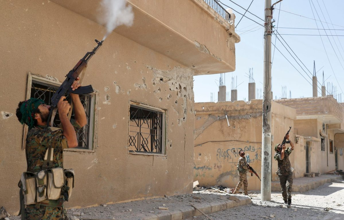 In one of Reuters' pictures of the year for 2017, Kurdish fighters fire rifles at a drone operated by Islamic State militants in Raqqa, Syria, on June 16, 2017. Photo: Reuters / Goran Tomasevic