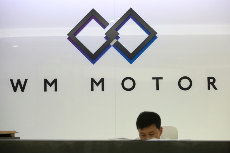 An employee of WM Motor Technology Co., Ltd. works at his office in shanghai, China, August 1, 2016. Photo: Reuters/Aly Song