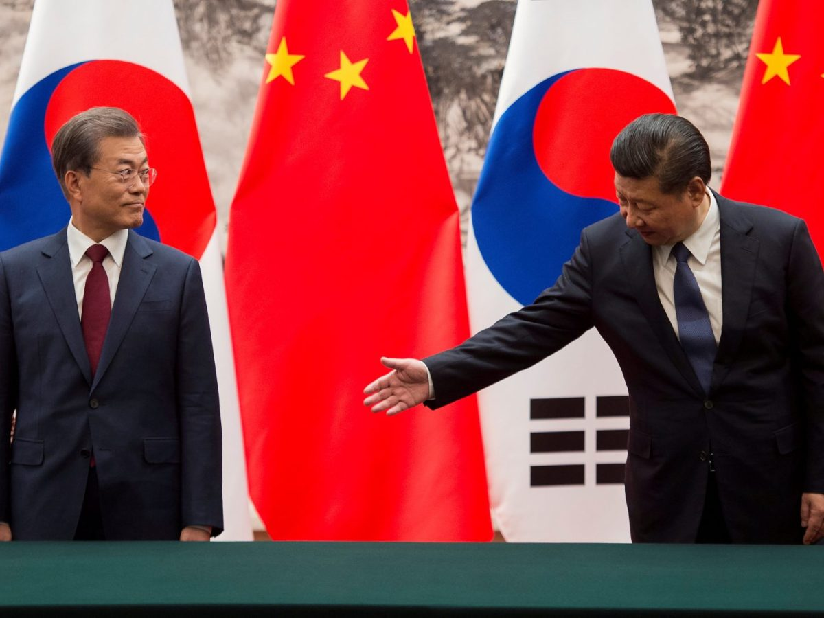 Chinese President Xi Jinping gestures towards South Korean President Moon Jae-In during a signing ceremony in Beijing. Photo: Reuters / Nicolas Asfouri