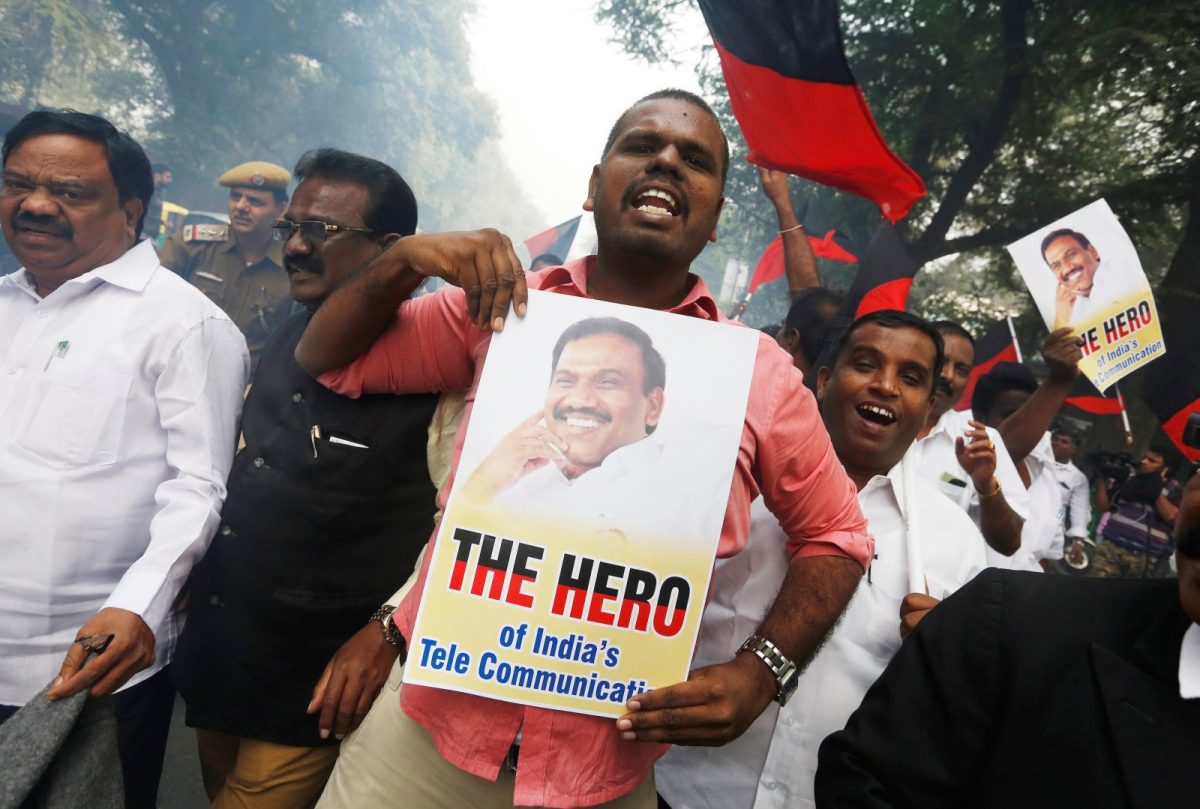 Supporters of Andimuthu Raja celebrate outside the court in New Delhi.  Photo: Reuters / Adnan Abidi