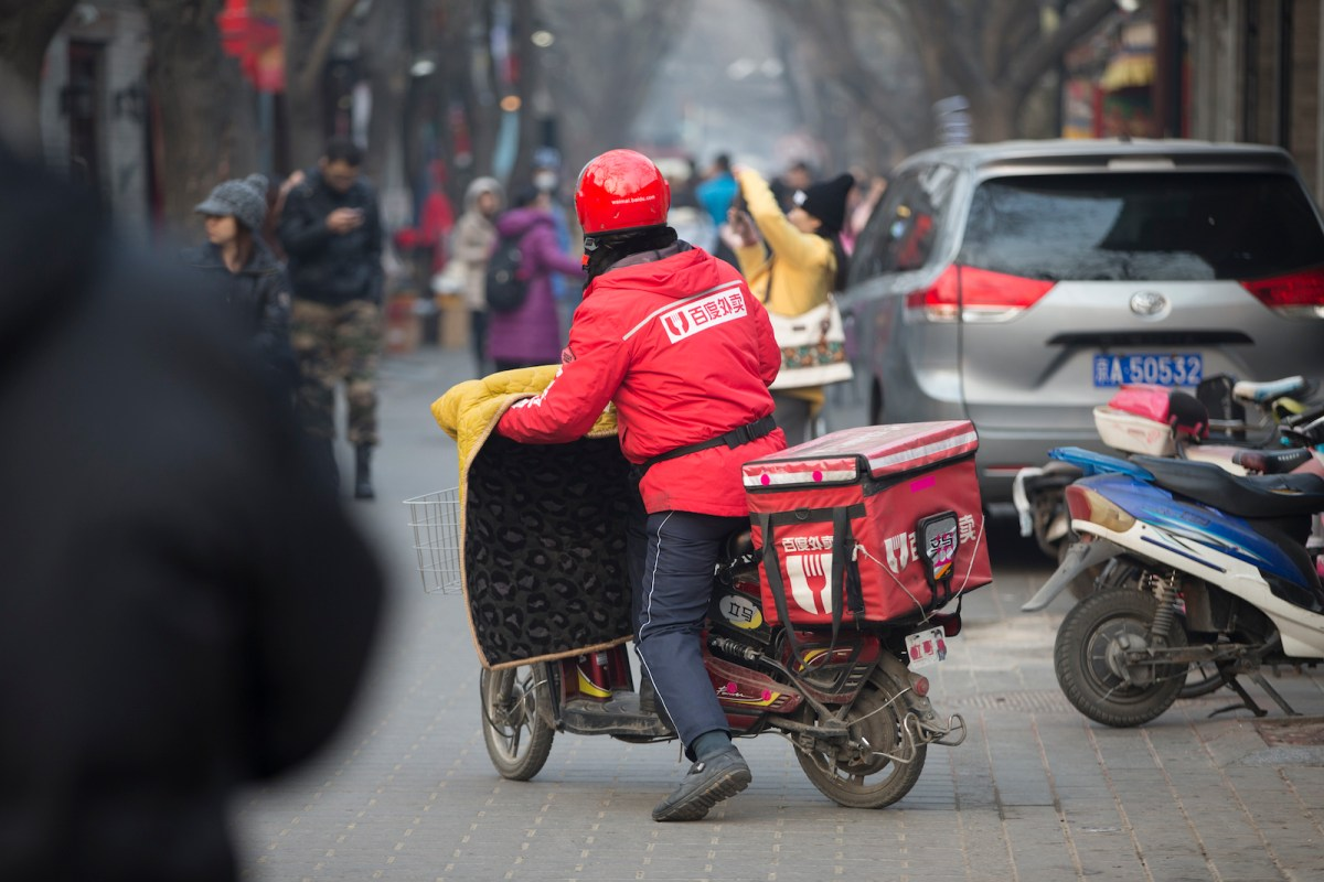Delivery drivers on electric motorbikes and scooters are part of the Beijing landscape. Photo: iStock