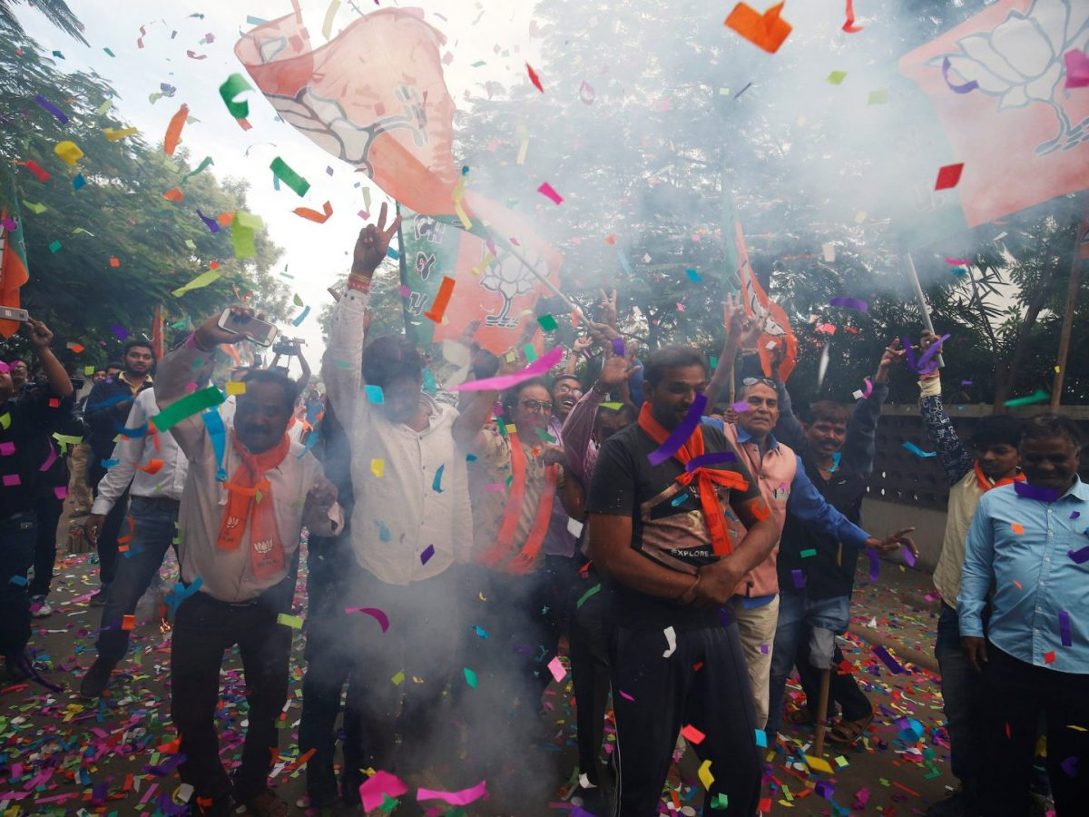 Supporters of India's Bharatiya Janata Party celebrate the initial Gujarat poll results outside the party office in Ahmedabad on December 18, 2017. Photo: Reuters / Amit Dave