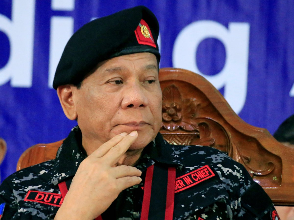 Philippine President Rodrigo Duterte, wearing a military uniform, gestures as he attends the 67th founding anniversary of the First Scout Ranger regiment in San Miguel town, Bulacan province, north of Manila, November 24, 2017. Photo: Reuters /Romeo Ranoco