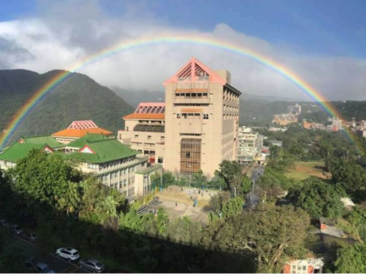 The record-breaking rainbow is seen above the campus in Taipei. Photo: Chinese Culture University