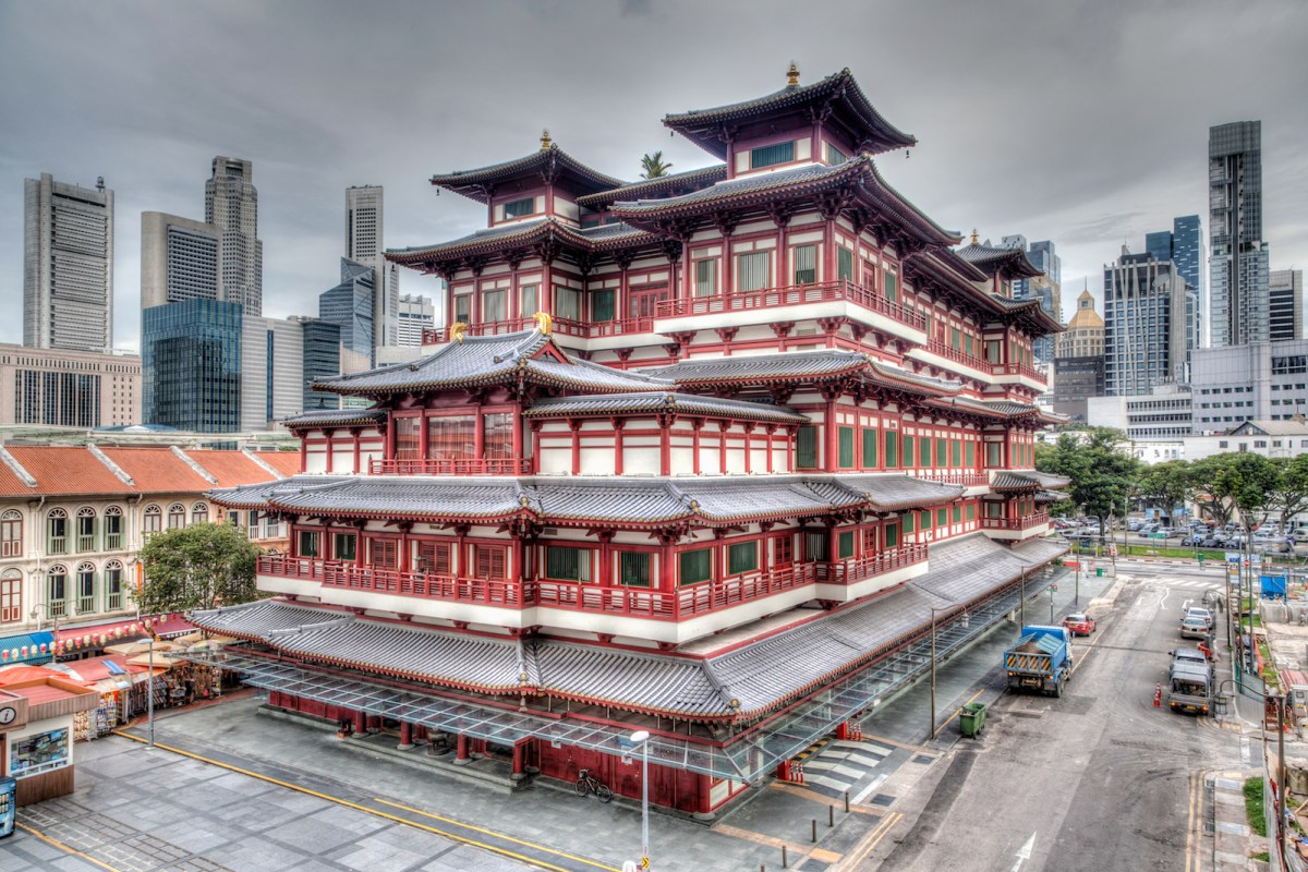 A rendering of the Buddha Tooth Relic Temple in Singapore's Chinatown, with the city's skyscraper business district in the background. Image: iStock/Getty Images