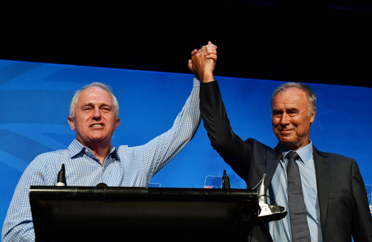 Prime Minister Malcolm Turnbull and newly elected John Alexander celebrate at a by-election party in Sydney. Photo: AAP Mick Tsikas via Reuters