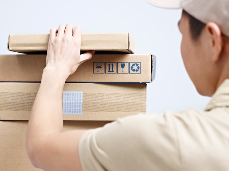 Deliveryman checking packages to be delivered. Photo: iStock