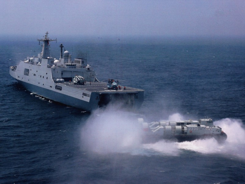 An air-cushioned landing boat slides from a Type 071 amphibious ship during a drill. Photo: PLA Daily