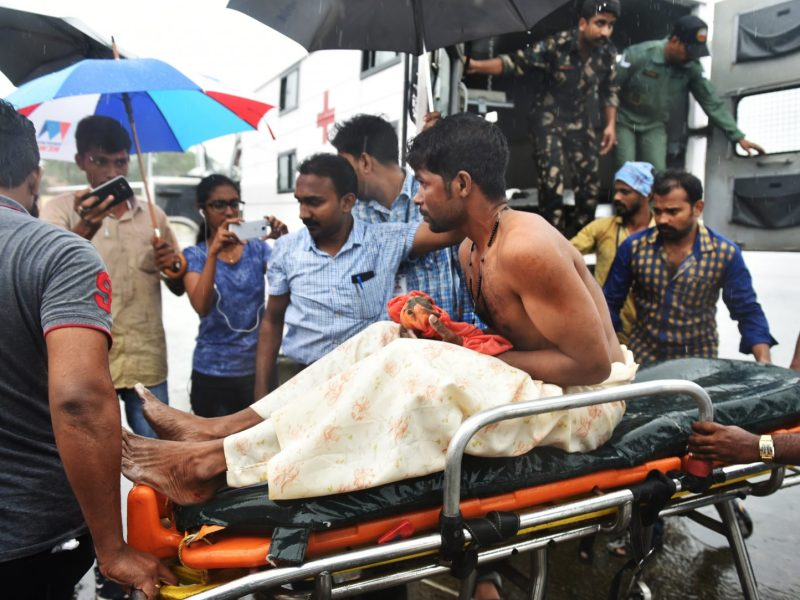 Indian officials carry a stranded fisherman, rescued by naval and air force helicopters from the Ockhi cyclone, at Thiruvananthpuram airport on December 1, 2017. Photo: AFP