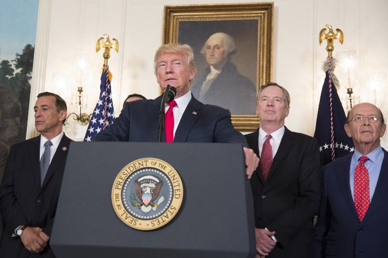 United States President Donald Trump speaks before signing a memorandum on addressing China's practices related to intellectual property in August. Photo: AFP
