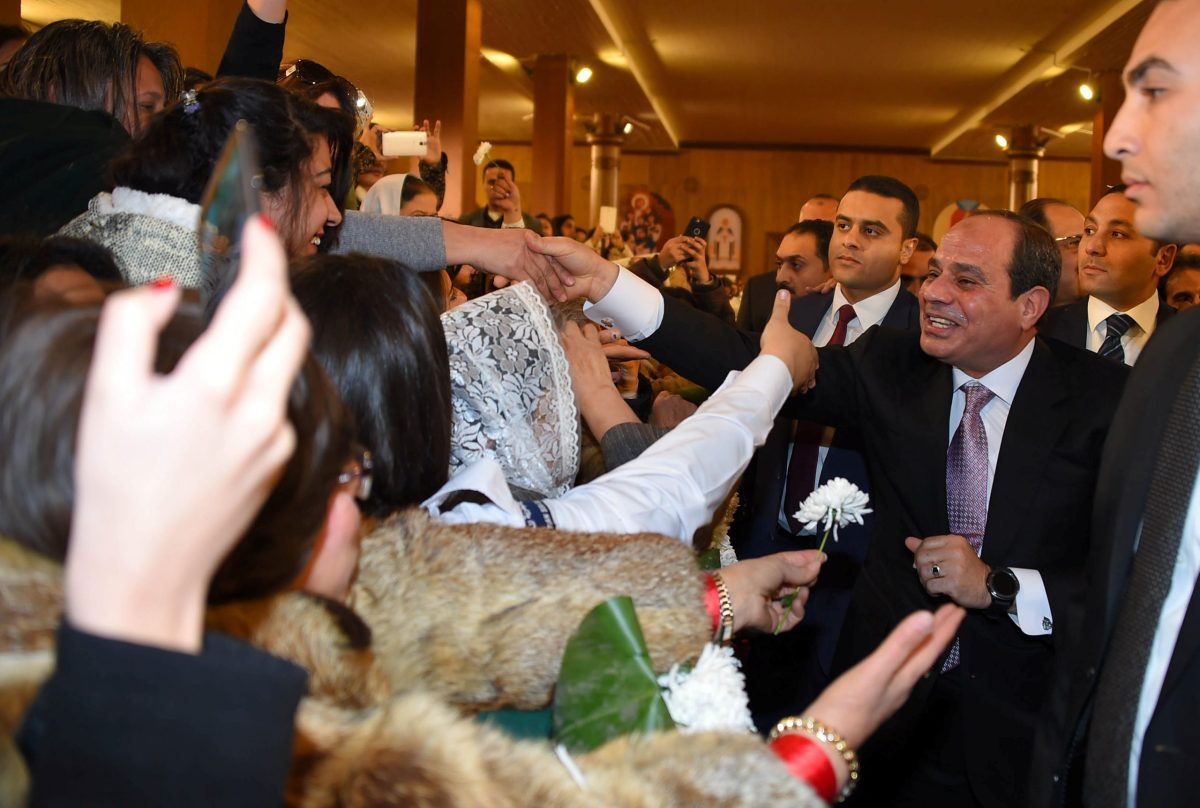 """Egyptian President Abdel Fattah al-Sisi (right) greets Copts at the new """"Nativity of Christ"""" Coptic Cathedral in Cairo. Photo: The Egyptian Presidency / Handout via Reuters"""