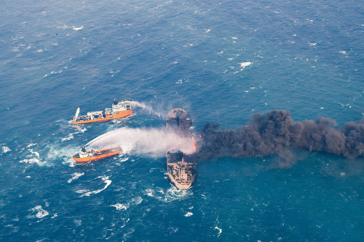 Rescue ships work to extinguish the fire on the Panama-registered Sanchi tanker carrying Iranian oil, which went ablaze after a collision with a Chinese freight ship in the East China Sea. China Daily via Reuters
