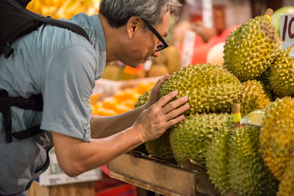 A Chinese shopper inspects a durian at a market in Hong Kong. Photo: iStock/Getty Images