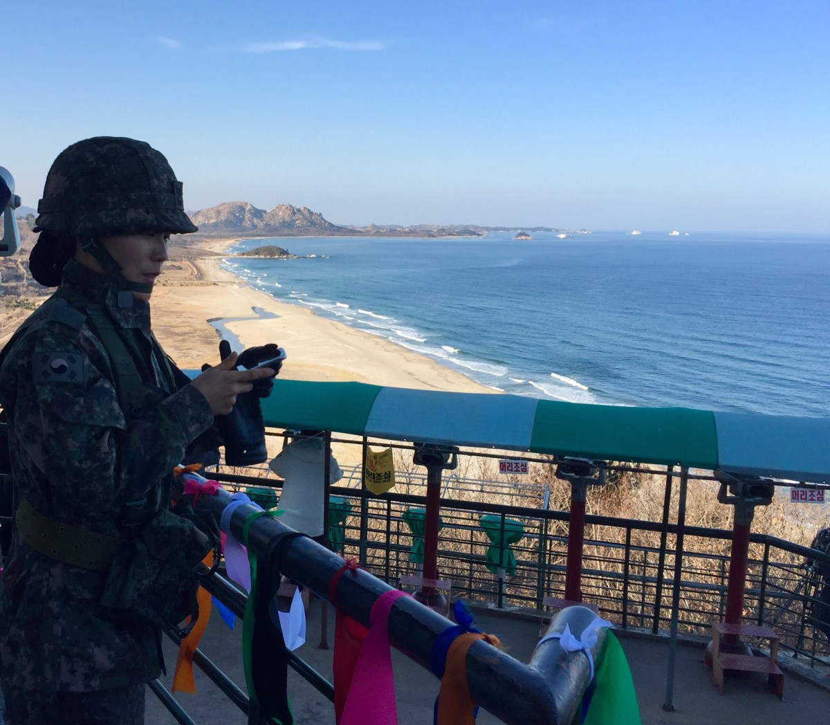 A South Korean soldier stands at an OP just south of the DMZ, with North Korea in the distance. Photo: Andrew Salmon