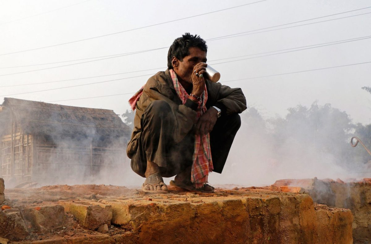 A laborer drinks tea inside a brick factory on the outskirts of Agartala, in northeast India's Tripura state. Photo: Reuters/Jayanta Dey