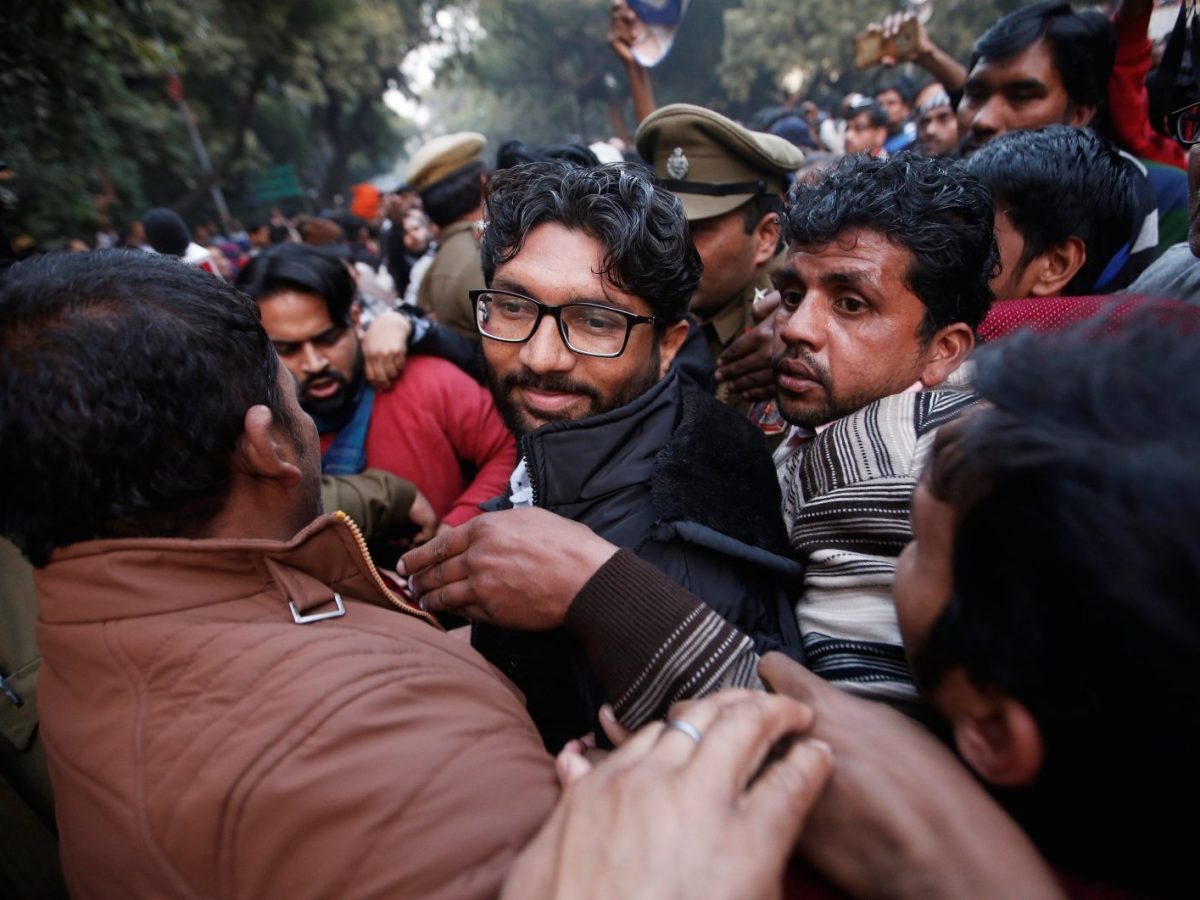 Jignesh Mevani, centre, an elected lawmaker who hails from the Dalit community, leaves after attending a rally in Delhi on January 9, which organizers said was held to demand the release of Chandrashekher Azad, founder of the pro-Dalit Bhim Army. Photo: Reuters/ Adnan Abidi