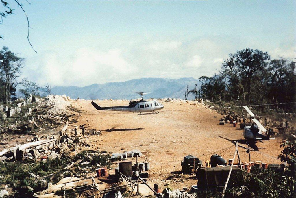 Air America helicopters land on top of Phou Pha Thi mountain during the US' 'secret war' in Laos. Photo: Walt Darran