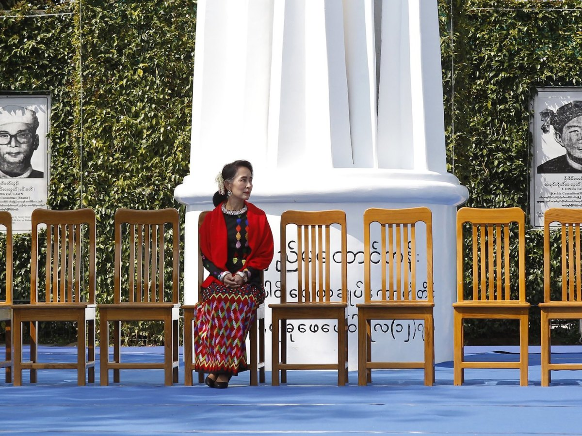 Myanmar State Counsellor Aung San Suu Kyi sits for a group photo during the 21st Century Panglong peace talks with ethnic representatives to mark 70th anniversary of Myanmar Union Day in Panglong, Southern Shan State, on February 12, 2017. Photo: AFP/Lamin Tun