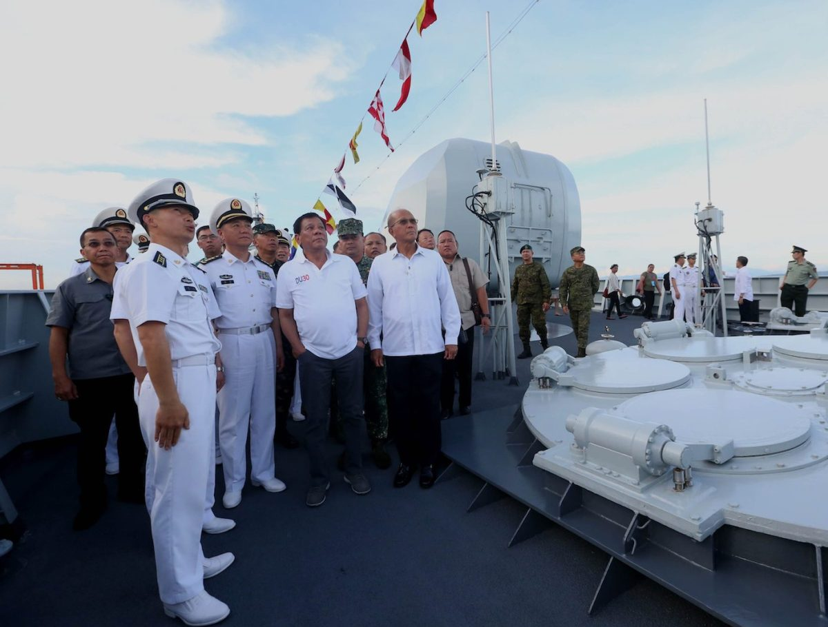 Philippine President Rodrigo Duterte (C) standing beside missile tubes on deck while touring the guided missile frigate Changchun berthed at the Davao international port on May 1, 2017. Photo: AFP/Simeon Celi