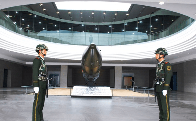 Chinese soldiers stand guard over a model of a nuclear warhead in a nuclear lab in China's northwestern Qinghai province. Photo: Xinhua