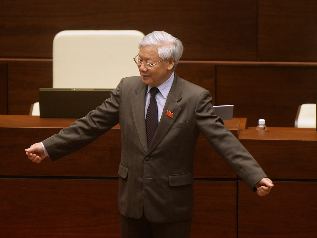 Vietnam Communist Party Secretary General Nguyen Phu Trong gestures as he waits for deputies to join him on the podium for a group photo at the end of the final meeting of the outgoing parliament in Hanoi on April 12, 2016.Photo: AFP/Hoang Dinh Nam