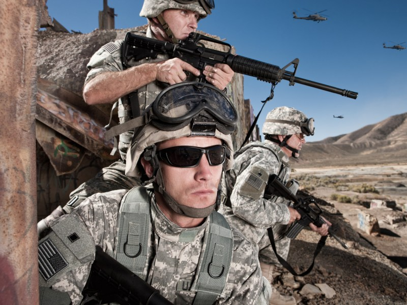 US Army soldiers take a defensive position in the desert, ready for any trouble that comes their way. Photo: iStock