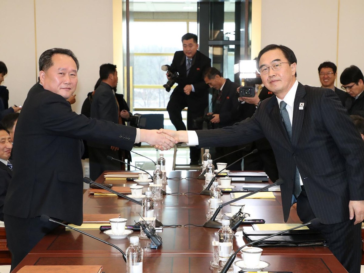 Head of the North Korean delegation Ri Son Gwon shakes hands with his South Korean counterpart Cho Myoung-gyon during their meeting at the truce village of Panmunjom in the demilitarised zone separating the two Koreas on January 9, 2018. Photo: Yonhap via Reuters