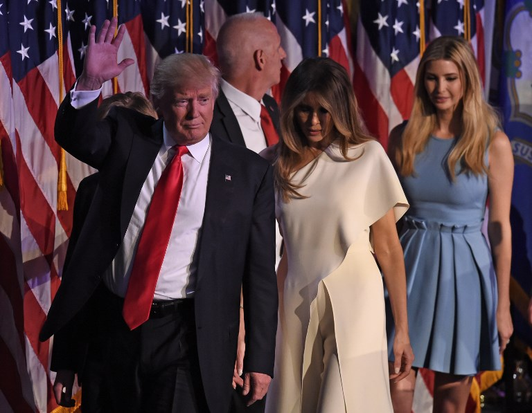Republican presidential candidate Donald Trump flanked by his wife Melania and members of his family waves after speaking to supporters during election night. Photo: AFP/Timothy A. CLARY