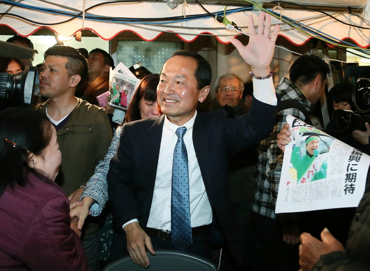 Taketoyo Toguchi (center) is surrounded by supporters in Nago, Okinawa prefecture, on February 4, 2018. Photo:  AFP / Jiji Press / Japan Out