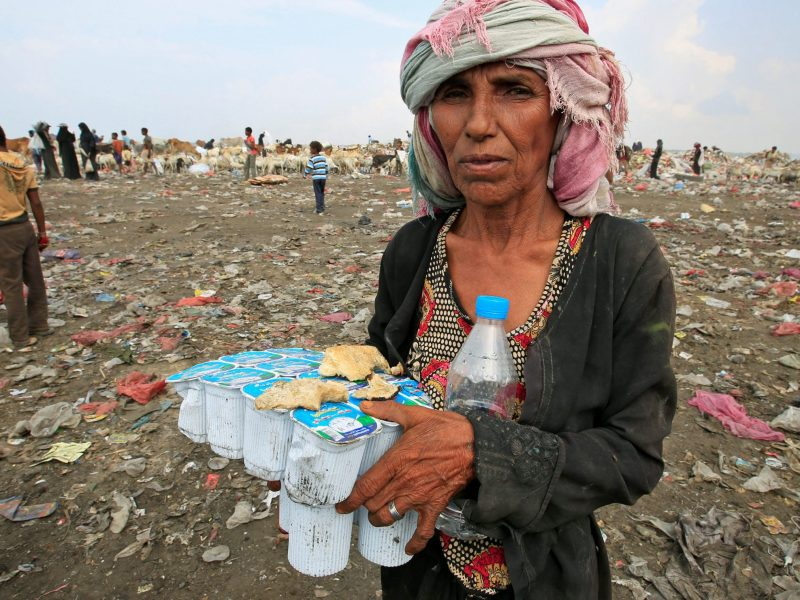 A woman holds expired yogurt she has found at a garbage dump on the outskirts of the Red Sea port city of Hodeida, Yemen, on January 7, 2018. Photo: Reuters / Abduljabbar Zeyad