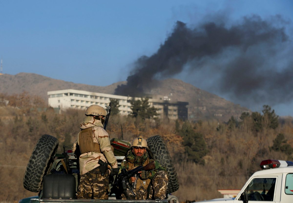 Afghan security forces keep watch as smoke rises from the Intercontinental Hotel in Kabul, Afghanistan January 21, 2018. Photo: Reuters/Omar Sobhani