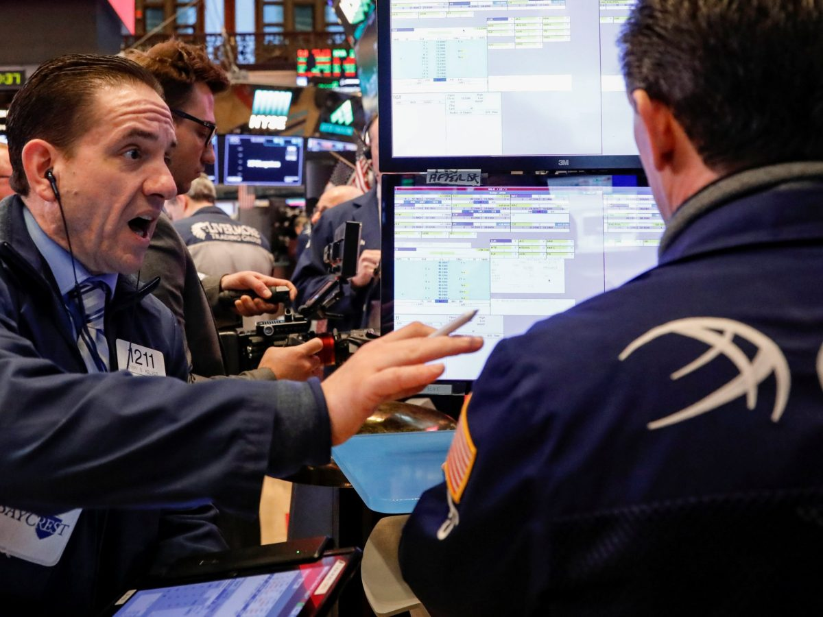 Traders work on the floor of the New York Stock Exchange. Photo: Reuters/Brendan McDermid