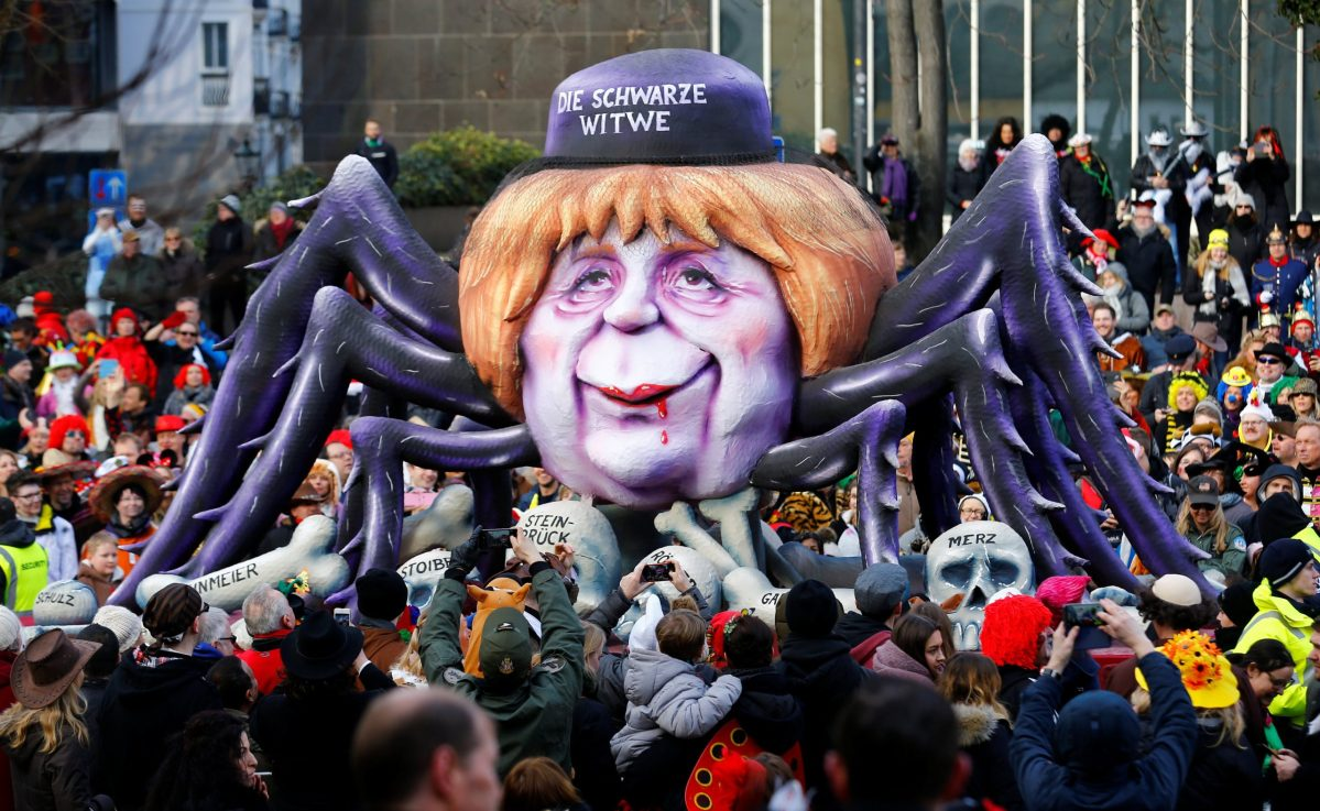 """A carnival float shows Christian Democratic Union (CDU) leader and German Chancellor Angela Merkel as black widow at the traditional """"Rosenmontag"""" Rose Monday carnival parade in Duesseldorf, Germany, February 12, 2018.   Photo: Reuters/Thilo Schmuelgen"""