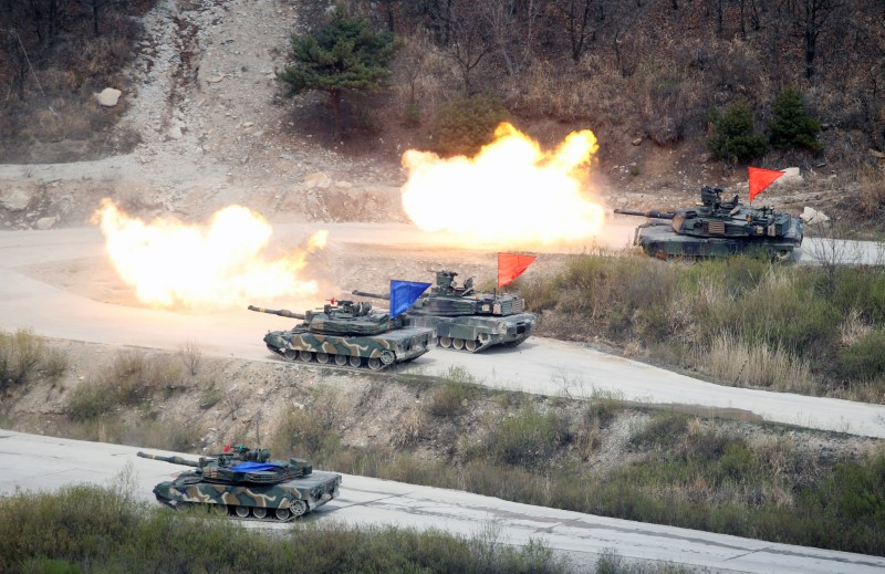 South Korean Army K1A1 and US Army M1A2 tanks fire live rounds during a US-South Korea joint live-fire military exercise, at a training field, near the demilitarized zone, separating the two Koreas in Pocheon, South Korea. Photo: Reuters/Kim Hong-Ji