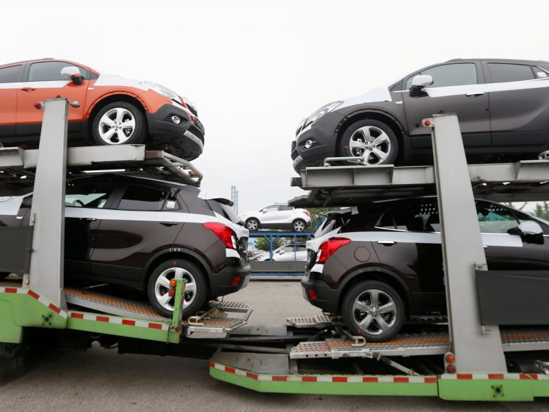 Cars made by GM Korea are seen on trucks at the company's Bupyeong plant, ready for export. Photo: Reuters / Lee Jae-Won