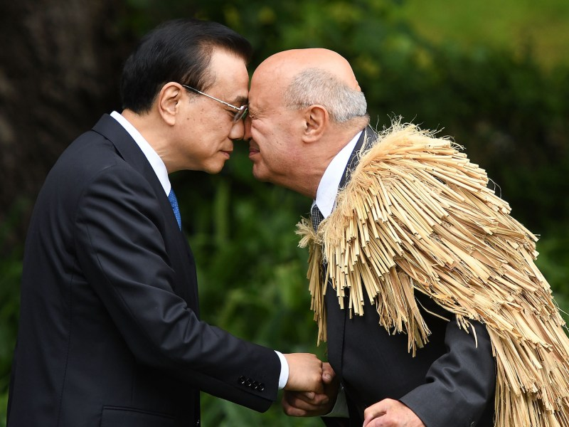 China's Premier Li Keqiang (L) is welcomed to New Zealand's Government House by a Maori elder during a welcome ceremony in Wellington on March 27, 2017. Photo: AFP/ Marty Melville