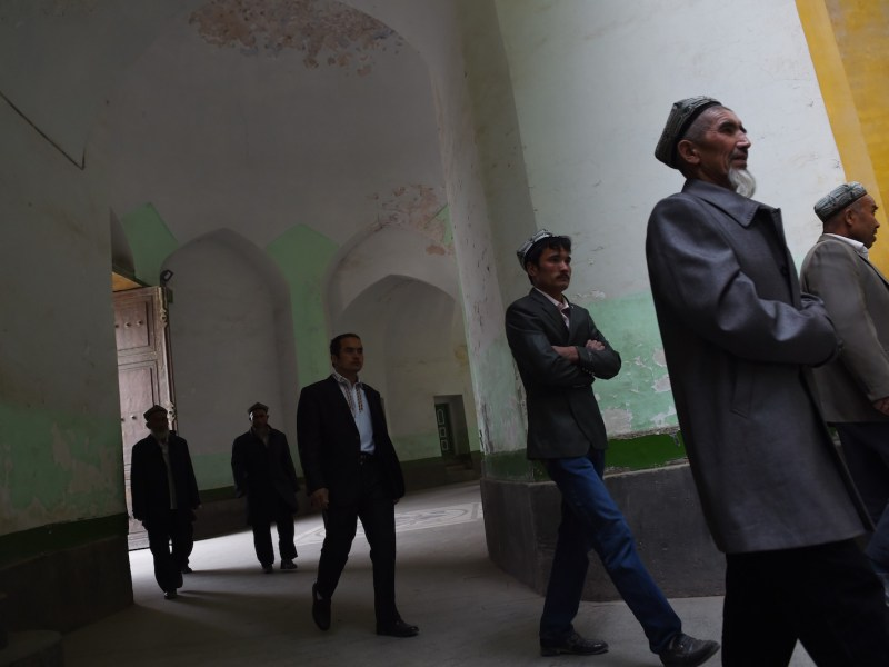 Uighur men walking into the Id Kah mosque for afternoon prayers in Kashgar, in China's western Xinjiang region in a 2015 photo. Photo: AFP/Greg Baker