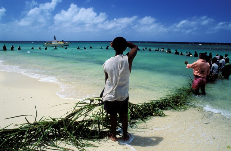 Villagers in a traditional fishing ceremony in Vatulele island, Yavi Rao Fiji. Photo: AFP Forum