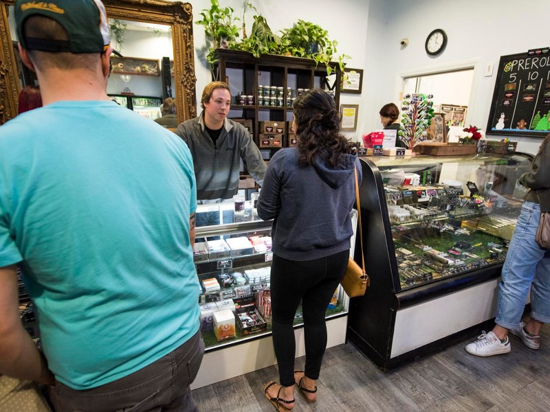 A 'budtender' helps a customer at the Higher Path medical marijuana dispensary in Los Angeles, California on December 27, 2017. Photo: AFP/Robyn Beck