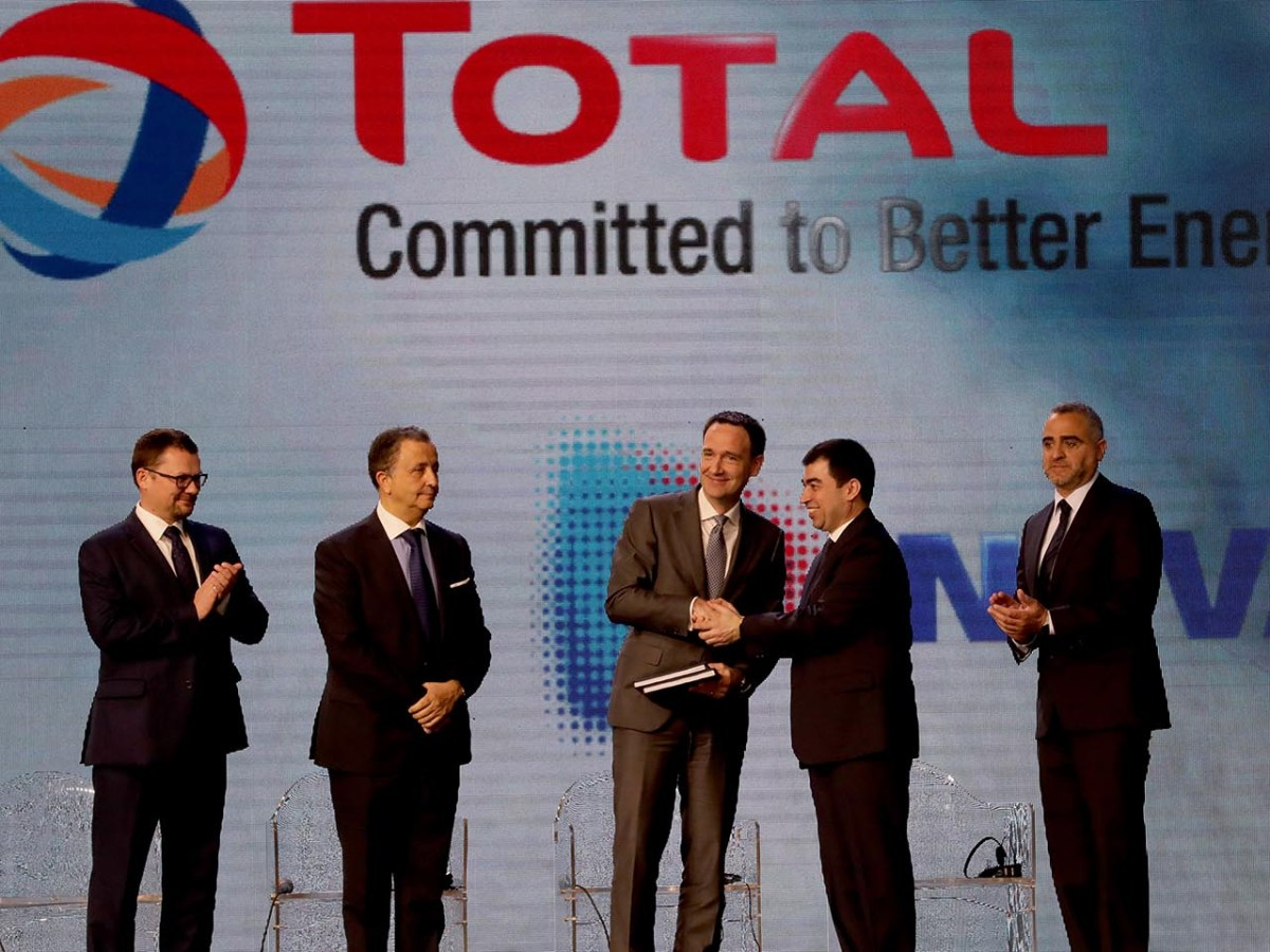 Lebanon's Energy Minister, Cesar Abi Khalil (second right), exchanges contracts with Stephane Michel, Total's head of exploration and production in the Middle East and North Africa during a signing ceremony in Beirut on February 9. Photo: AFP/Anwar Amro