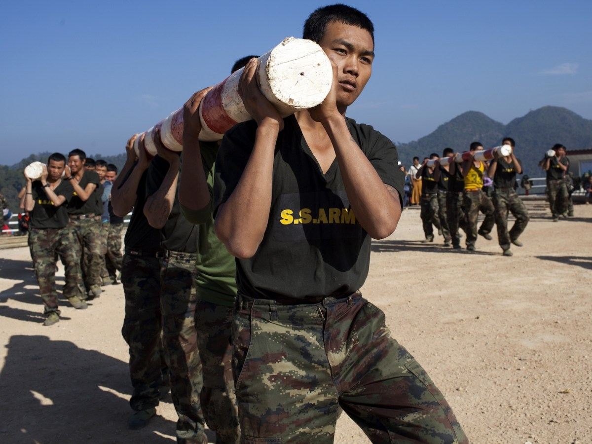Shan State Army - South (SSA-S) soldiers exercising with logs at their headquarters in Loi Tai Leng, in Myanmar's northeastern Shan State, Photo: AFP/KC Ortiz