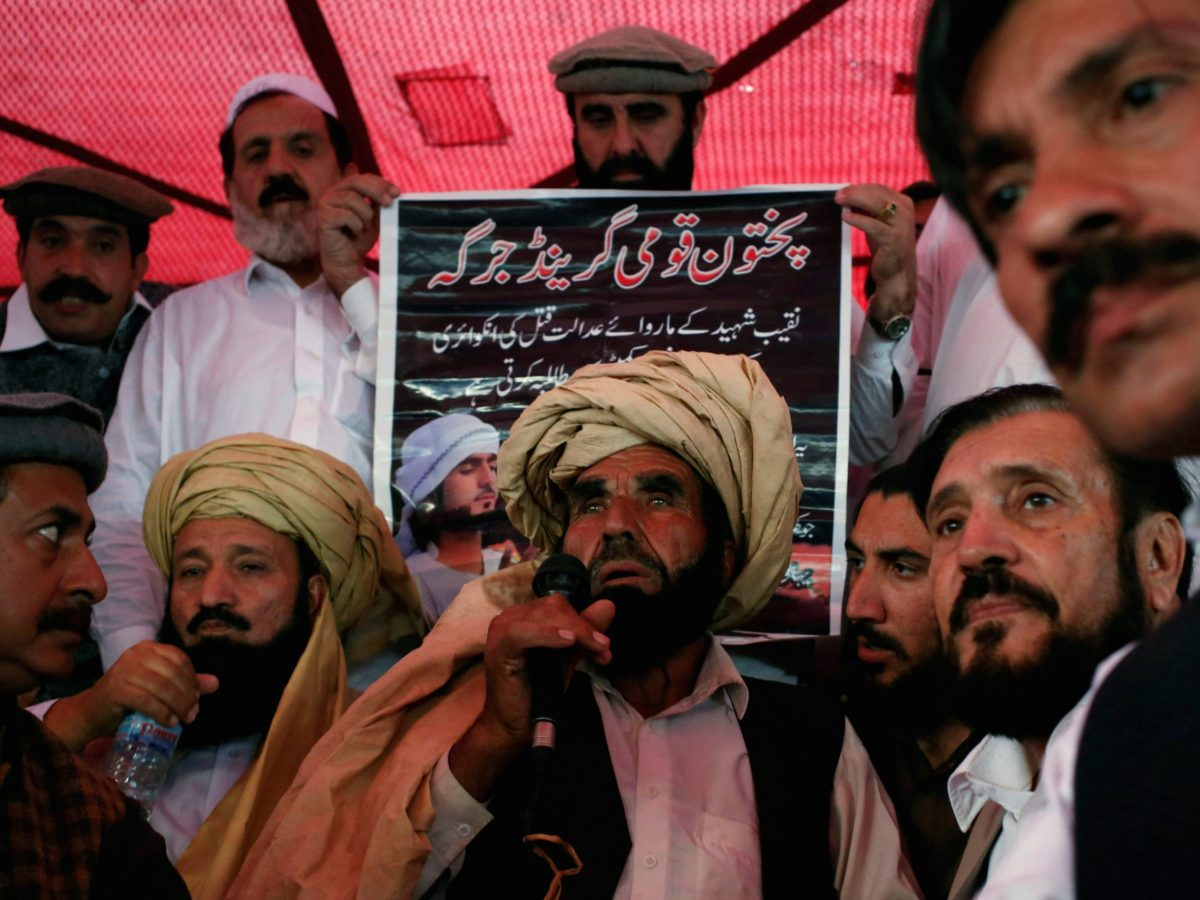 "Muhammad Khan Mehsud (C), the father of Naqibullah Mehsud, whose family said was killed by police in a so-called ""encounter killing"", speaks to grand jirga (tribal assembly or public meeting) in Karachi, Pakistan January 22, 2018. Photo: REUTERS/Akhtar Soomro"