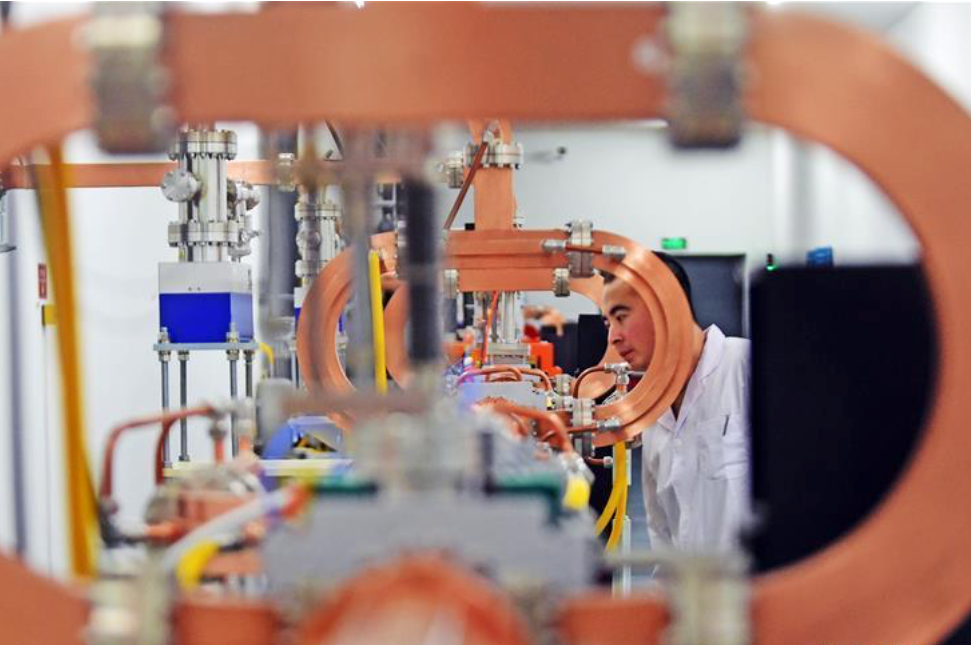 A scientist works on photon source equipment inside a lab at the Chinese Academy of Sciences. Photo: Xinhua